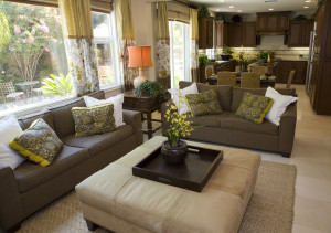 brown couch with accent yellow trimmed accent pillows